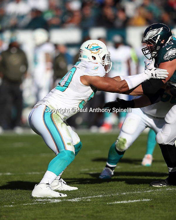 Miami Dolphins defensive end Olivier Vernon (50)) works his way around a block during the 2015 week 10 regular season NFL football game against the Philadelphia Eagles on Sunday, Nov. 15, 2015 in Philadelphia. The Dolphins won the game 20-19. (©Paul Anthony Spinelli)