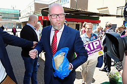 &copy; Licensed to London News Pictures. 07/06/2017<br /> Paul Nuttall eating a bag of white seedless grapes on walk about with PETER WHITTLE UKIP Candidate for South Basildon and East Thurrock.<br /> UKIP Leader Paul Nuttall in Corrington,Essex this afternoon on a walkabout on the last day of the election campaign for 2017.<br /> Photo credit: Grant Falvey/LNP