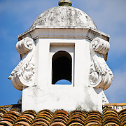 Spanish colonial chimney on a rooftop in Antigua Guatemala. Famous for its well-preserved Spanish baroque architecture as well as a number of ruins from earthquakes, Antigua Guatemala is a UNESCO World Heritage Site and former capital of Guatemala.