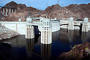 Hoover Dam, also known as Boulder Dam, is standing in the Black Canyon of the Colorado River, forming Lake Mead, on the border between Nevada and Arizona, USA. Constructed between 1931 and 1936 by President Franklin D. Roosevelt, its construction was the result of a massive effort involving thousands of workers. Lake Mead is 180 km long, and when filled to capacity can reach 28 million acre-feet of water. However, the lake has not reached this capacity in more than a decade, due to increasing droughts.