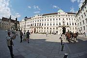 Hofburg (royal castle). Tourists and Fiakers.