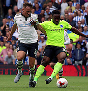 Kazenga LuaLua holding off Lasse Vigen Christense during the Sky Bet Championship match between Fulham and Brighton and Hove Albion at Craven Cottage, London, England on 15 August 2015. Photo by Matthew Redman.