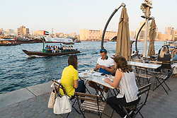 Cafe on waterfront of The Creek in Al Fahidi historic district in Bur Dubai United Arab Emirates