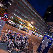 Bike share installation of rentable bicycles in downtown Kansas City Missouri at 10th and Main Transit Center.
