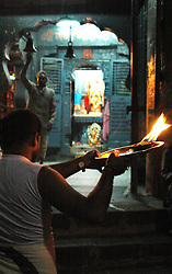 "India, Nasik, 2006. Nasik?s holiest place is the Ramkund, where each evening a public ""puja,"" or Hindu cleansing ceremony takes place."