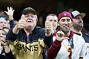 NEW ORLEANS, LA - NOVEMBER 19:  Fan of the New Orleans Saints celebrates next to a disappointed fan of the Washington Redskins at Mercedes-Benz Superdome on November 19, 2017 in New Orleans, Louisiana.  Saints defeated the Redskins 34-31.  (Photo by Wesley Hitt/Getty Images) *** Local Caption ***