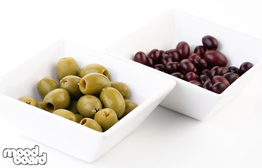 Pickled olives in white bowl