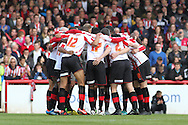 Picture by David Horn/Focus Images Ltd +44 7545 970036.27/04/2013.Brentford players get ready for the start of the biggest game of their season before the npower League 1 match at Griffin Park, London.