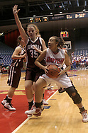 The Flyers Aundrea Lindsey (right) looks toward the basket and the Fordham Rams Annie Zopf (35) tries to keep her from shooting during a UD Women's basketball game at the University of Dayton Arena, January 21, 2007.