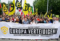 """11.06.2016, Wien, AUT, Demonstration der Identitären Bewegung Österreich mit diversen Gegendemonstrationen. im Bild Identitäre mit Plakat """"Europa verteidigen"""" // participants of the Identitarian movement with banner """"defend europe"""" during demonstration of the right group """"Identitaeren"""" and left-wing counter demonstrations in Vienna, Austria on 2016/06/11. EXPA Pictures © 2016, PhotoCredit: EXPA/ Michael Gruber"""