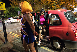 © Licensed to London News Pictures . 28/10/2018. Manchester, UK. A man dressed as Geri Halliwell from the Spice Girls , steps out of a taxi . Revellers on a night out , many in fancy dress , on the weekend before Halloween . Photo credit: Joel Goodman/LNP