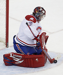 Dec 16, 2009; Newark, NJ, USA; Montreal Canadiens goalie Carey Price (31) makes a stick save during the third period of their game against the New Jersey Devils at the Prudential Center. The Devils won 2-1.