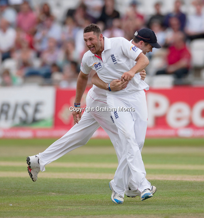 Tim Bresnan celebrates (with James Anderson) the first ball lbw of Mahendra Singh Dhoni during the second npower Test Match between England and India at Trent Bridge, Nottingham.  Photo: Graham Morris (Tel: +44(0)20 8969 4192 Email: sales@cricketpix.com) 01/08/11