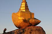 Pilgrim praying at Pilgrims at sunset before the golden rock, Kytiku, Myanmar, Asia