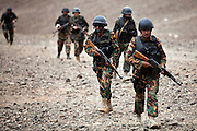Members of the Yemen Special Forces Counter-Terrorism squad run up a hillside armed with automatic weapons during  live-fire drills at a training range on the outskirts of Sana'a, Yemen April 14, 2010. Yemen continues efforts to improve the quality of its' armed forces as it faces a Houthi rebel movement in the North, a  separatist movement in its Southern territory, and Al Qaeda terrorist activity.