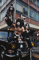 American rock group Kiss arrive at London airport for their first European tour, already sporting their face paint and costumes, 10th May 1976. Clockwise from top left, they are lead singer Gene Simmons, guitarist Ace Frehley, drummer Peter Criss and guitarist Paul Stanley.