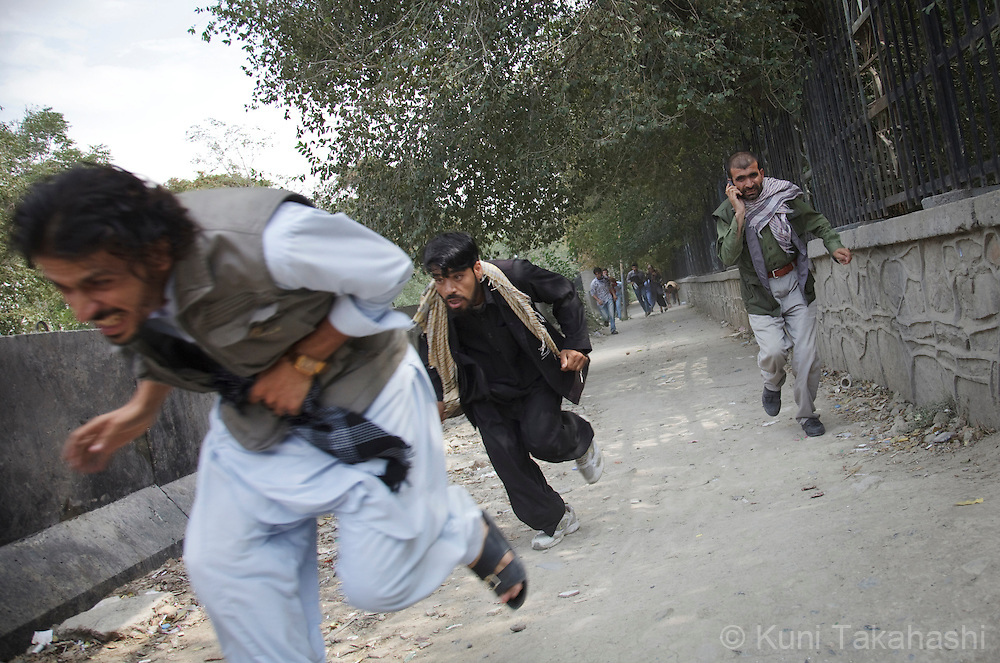 People run from gunfire followed by rocket attack near the U.S Embassy during multiple insurgent attacks in Kabul, Afghanistan on Sep 13, 2011. Terrorists attacked multiple locations including U.S. Embassy and a nearby NATO base in Kabul..(Photo by Kuni Takahashi)