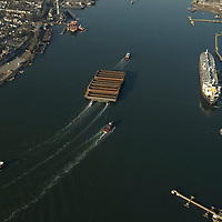 Aerial photographs of the Tugboat, Ranger (Crowley Maritime) pulling 17 barges through the New York Harbor<br />