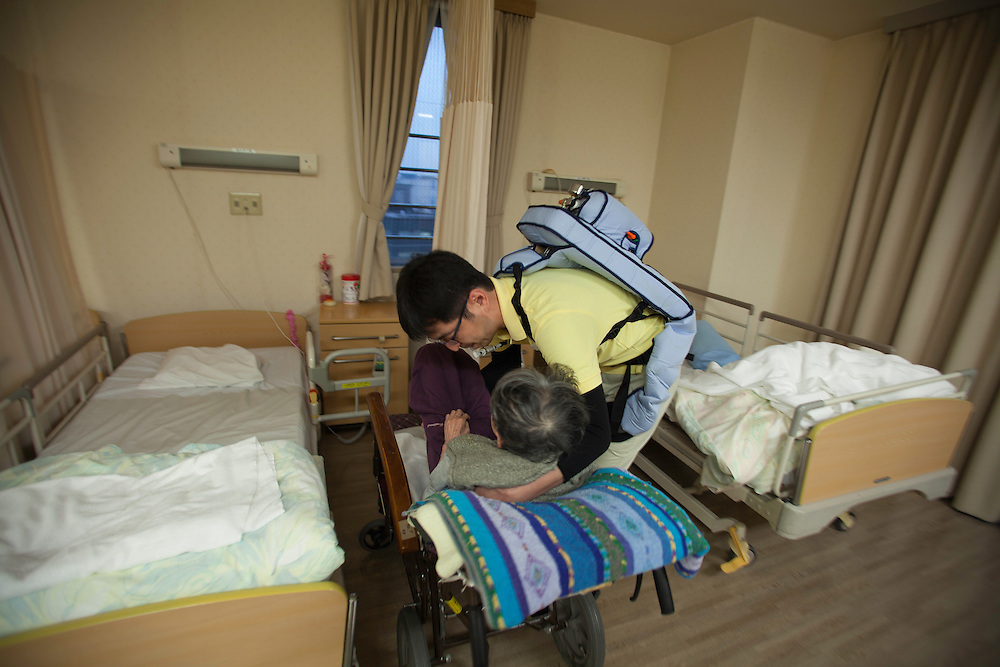 Silver Wings Senior Care Center . the center one of the  first in tokyo to take advantage of robots and other mecihinal assit devices such as this pneumatic  Exo skeleton which helps care givers  lift  additional weight and reduce injuries.