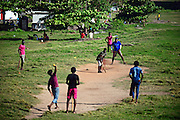 Young men playing cricket at UNESCO World Heritage, Galle Fort, during Binara Full Moon Poya Day.