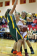 Marion's Dani Peyton (24) tries to drive between Beckman's Katie Pirc (21) and Mariah Hargrafen (33) during their game at Marion High School, 675 South 15th Street, in Marion, on Tuesday evening, November 22, 2011. (Stephen Mally/Freelance)