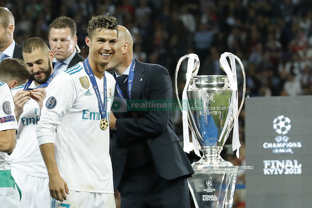 (L-R) Karim Benzema of Real Madrid, Cristiano Ronaldo of Real Madrid, coach Zinedine Zidane of Real Madrid during the UEFA Champions League final between Real Madrid and Liverpool on May 26, 2018 at NSC Olimpiyskiy Stadium in Kyiv, Ukraine