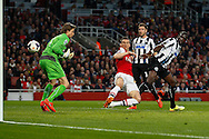Laurent Koscielny of Arsenal scores the opening goal during the Barclays Premier League match at the Emirates Stadium, London<br /> Picture by David Horn/Focus Images Ltd +44 7545 970036<br /> 28/04/2014