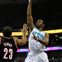 March 30, 2011; New Orleans, LA, USA; New Orleans Hornets point guard Chris Paul (3) shoots over Portland Trail Blazers power forward Marcus Camby (23) during the first half at the New Orleans Arena.    Mandatory Credit: Derick E. Hingle