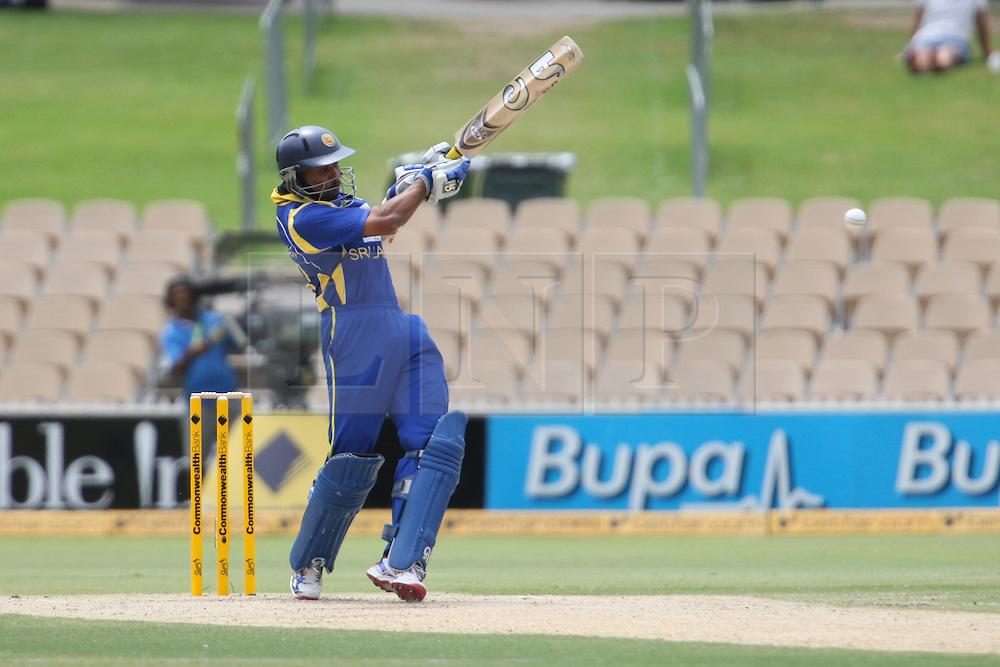 © Licensed to London News Pictures. 14/02/2012. Adelaide Oval, Australia. Sri Lankan batsmen Tillakaratne Dilshan plays a pull shot during the One Day International cricket match between India Vs Sri Lanka. Photo credit : Asanka Brendon Ratnayake/LNP