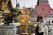 Tourist visits the Grand Palace Complex, Bangkok, Thailand