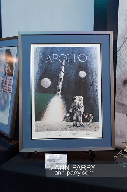 Garden City, New York, U.S. June 6, 2019. 'Navy to the Moon' Artist Proof by Bob Rasmussen - signed by  Neil Armstrong, Gene Cernan, Alan Shepard, Jim Lovell - is one of the Silent Auction fundraiser space memorabilia items on display during Apollo at 50 Anniversary Dinner, an Apollo astronaut tribute celebrating the Apollo 11 mission Moon landing.