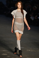Alla Kostromicheva walks the runway wearing Alexander Wang Spring 2010 collection during Mercedes-Benz Fashion Week in New York, NY on September 11, 2009