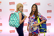 "TV personality Leeza Gibbons, left, and Jaime Primak Sullivan, star of ""Jersey Belle"" and ""CawfeeTawk,"" get ready for back-to-school season with backpacks from Staples during BlogHer15 in New York, Friday, July 17, 2015.  (Photo by Diane Bondareff/Invision for Staples/AP Images)"