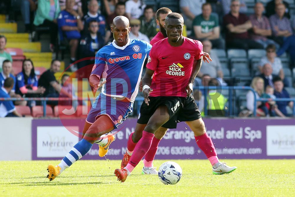 Gabriel Zakuani of Peterborough United is tracked by Calvin Andrew of Rochdale - Mandatory byline: Joe Dent/JMP - 07966386802 - 08/08/2015 - FOOTBALL - Spotland Stadium -Rochdale,England - Rochdale AFC v Peterborough United - Sky Bet League One
