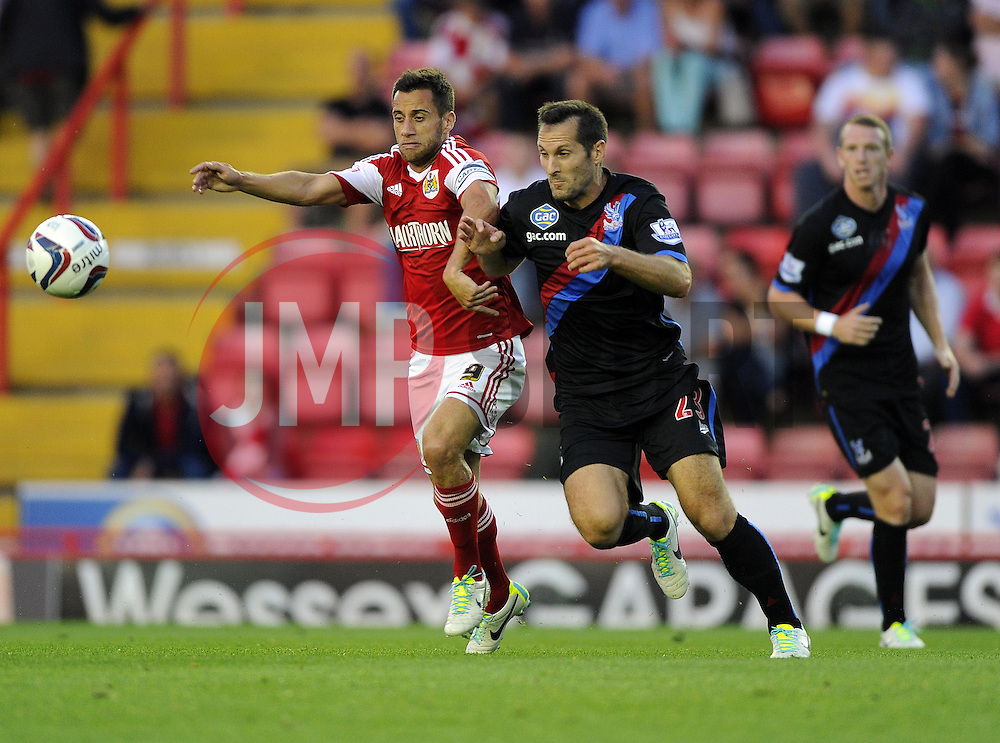 Bristol City's Sam Baldock battles for the ball with Crystal Palace's Florian Marange  - Photo mandatory by-line: Joe Meredith/JMP - Tel: Mobile: 07966 386802 27/08/2013 - SPORT - FOOTBALL - Ashton Gate - Bristol - Bristol City V Crystal Palace -  Capital One Cup - Round 2