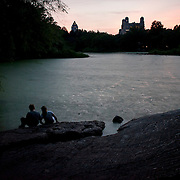 July 17, 2012 - New York, NY : Two youths drift away from the music to sit on the rocks by Belvedere Lake as the New York Philharmonic (not pictured) performs in Central Park on Monday evening.   CREDIT: Karsten Moran for The New York Times
