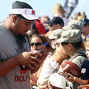 Polytech star, now Miami Dolphin Pro Bowl All Star Paul Soliai, greets thousands of military families at Hickam Air Base, Oahu, Hawaii after his NFC Pro Bowl practice.  Paul made a special video salute to the People of Samoa in Samoan and English that will be linked in todays Samoa News online.  Photo by Barry Markowitz, 1/26/12