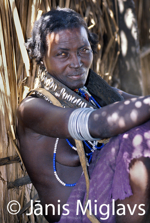An Aerbore woman sits, thinking in her hut, in Ethiopia's Omo region.