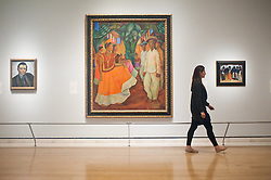 """Mexico: A Revolution in Art opens at the Royal Academy of Arts.<br /> employee walks past work by Diego Rivera entitled """"Dance in Tehuantepec, 1928"""" at the exhibition """"Mexico: A Revolution in Art, 1910 - 1940"""" which opens at the Royal Academy of Arts on the 6th of July. The show features over 120 paintings and photographs and examines the intense period of artistic creativity that took place in Mexico at the beginning of the 20th century,<br /> London, United Kingdom,<br /> Tuesday, 2nd July 2013<br /> Picture by Piero Cruciatti / i-Images"""