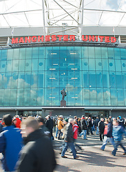MANCHESTER, ENGLAND - Sunday, March 23, 2008: Supporters walk past the statue of Sir Matt Busby outside the main entrance to Manchester United's Old Trafford stadium. (Photo by David Rawcliffe/Propaganda)