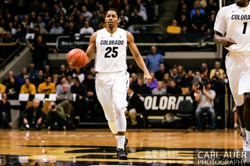 January 2nd, 2014:  Colorado Buffaloes junior guard Spencer Dinwiddie (25) brings the ball up the court in the first half of the NCAA Basketball game between the Oregon State Beavers and the University of Colorado Buffaloes at the Coors Events Center in Boulder, Colorado