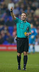 BIRKENHEAD, ENGLAND - Saturday, January 3, 2015: Referee Paul Tierney issues a yellow card during the FA Cup 3rd Round match between Tranmere Rovers and Swansea City at Prenton Park. (Pic by David Rawcliffe/Propaganda)