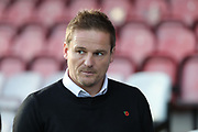 AFC Wimbledon manager Neal Ardley looking onto pitch during the EFL Sky Bet League 1 match between AFC Wimbledon and Peterborough United at the Cherry Red Records Stadium, Kingston, England on 12 November 2017. Photo by Matthew Redman.