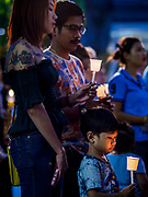 12 AUGUST 2018 - BANGKOK, THAILAND: A child stands in the crowd during a candlighting ceremony to honor the 86th birthday of Sirikit, the Queen Mother of Thailand at EmQuartier Mall in Bangkok. She was the wife of Bhumibol Adulyadej, the late King, and she is the mother of His Majesty King Maha Vajiralongkorn Bodindradebayavarangkun of Thailand, who succeeded his father. August 12 is also celebrated as Mother's Day in Thailand.    PHOTO BY JACK KURTZ
