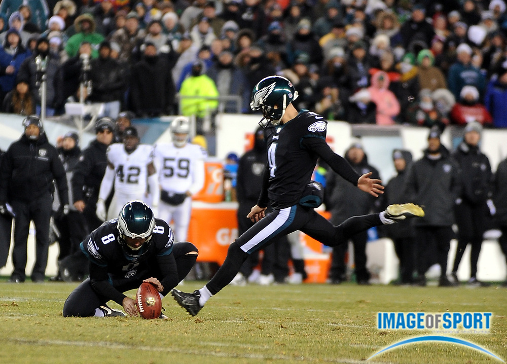 Dec 25, 2017; Philadelphia, PA, USA; Philadelphia Eagles kicker Jake Elliott (4) kicks out of the hold of punter Donnie Jones (8) during a NFL football game at Lincoln Financial Field. The Eagles defeated the Raiders 19-10. Photo by Reuben Canales