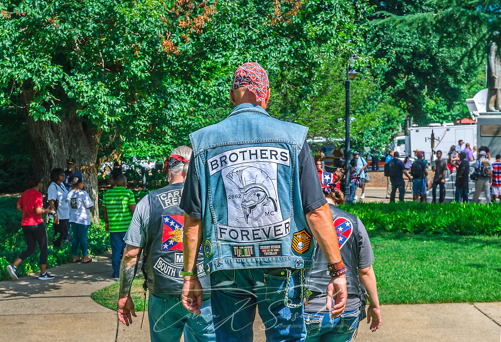 Members of the Carolina Rebels Motorcycle Club leave the South Carolina State House after protesting the removal of the Confederate flag, July 10, 2015, in Columbia, S.C. The flag flew above the capitol dome from 1961-2000, then was moved to the grounds. The flag, which is now permanently removed, will be stored at the Confederate Relic Room and Military Museum. The House voted for its removal after the shooting of nine African-Americans at Emanuel African Methodist Episcopal Church in Charleston, June 17, 2015. Alleged shooter Dylann Roof, who published a manifesto on his website supporting white supremacist beliefs, was seen in numerous photographs holding the Confederate flag. (Photo by Carmen K. Sisson/Cloudybright)