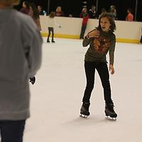 Isabella Kelly, 10, enjoys skating as fast as she can Saturday at the Bancorpsouth Arena