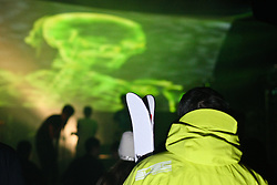 ©under licence to London News Pictures. 31 OCtober 2010, a skier watches band Danananaykroyd perform at the Relentless Freeze Festival 2010, Battersea Power Station, London. Held annually since 2008, Freeze features the world's best snowboarders and skiers  competing on a 32m high, 100m long, real snow ramp. 31 October 2010