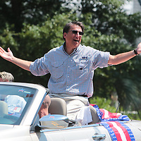 Governor Pat McCrory remarks to a spectator about the weather during the North Carolina 4th of July Festival Parade Friday July 4, 2014 in Southport, N.C.