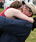 "October 24, 2010 - Boston, MA - Emily Casey of Arlington hugs her father Tom after the Arlington-Belmont Girls Varsity Crew team completed their first Head of the Charles Regatta on Sunday. Rick Stavres, A-B rowing director and head coach said, ""the rowing program is only two years old and already has about 100 members."" (Photos/Matt Wright 2010)"